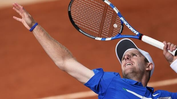 American Jesse Levine is seen here serving to Canada's Milos Raonic during their men's Singles 2nd Round tennis match of the French Open tennis tournament in May. Levine, who was born in Ottawa, is petitioning to represent Canada.