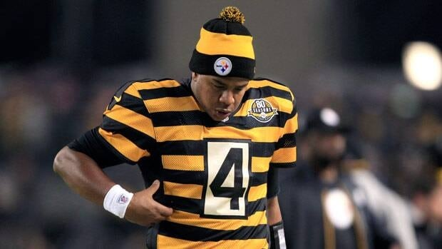 Pittsburgh Steelers quarterback Byron Leftwich checks his ribs after getting hit in the fourth quarter of Sunday night's game.