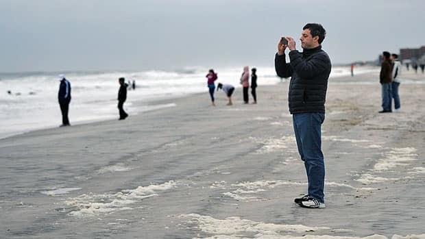 People in Long Beach, N.Y., await arrival of Hurricane Sandy, which could also reach Windsor-Essex by Monday night.