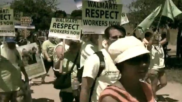 Wal-Mart has been criticized for keeping employees on part-time status and paying low wages. OURWal-Mart video shows a protest earlier this year.