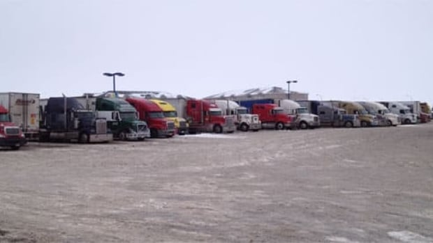 Semis at a Regina truck stop waiting for Highway 1 to open.
