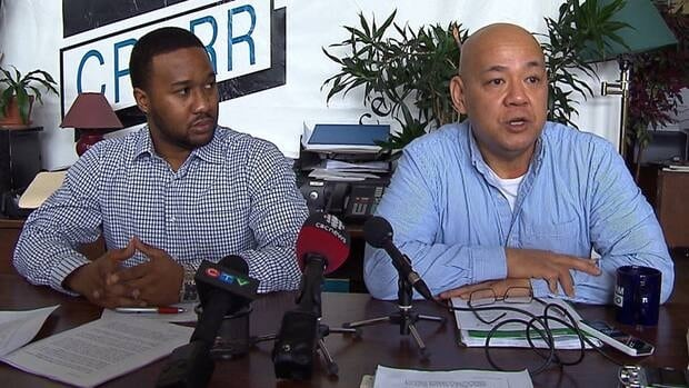 Farid Charles and Fo Niemi, director of the Center for Research Action on Race Relations, say two Montreal officers racially profiled Charles when they arrested him for loitering.