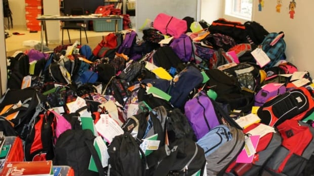 A huge pile of backpacks stuffed with school supplies await returning students in High River.