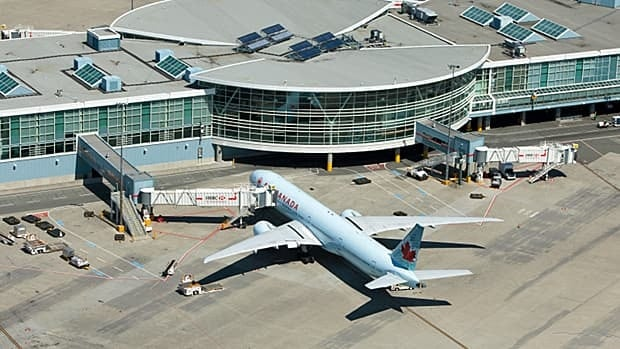 An Air Canada Boeing 777 sits at the international departure gate of Vancouver International Airport in May 2010.