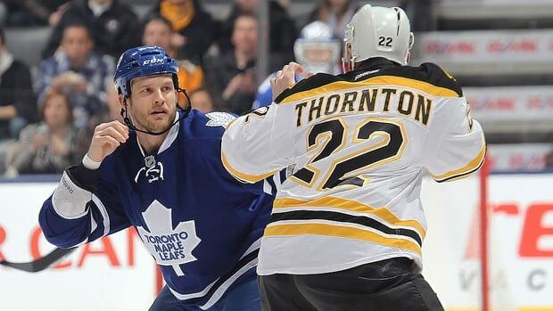 Shawn Thornton of the Boston Bruins, right, dukes it out with Colton Orr of the Toronto Maple Leafs on March 23, 2013 at the Air Canada Centre in Toronto.