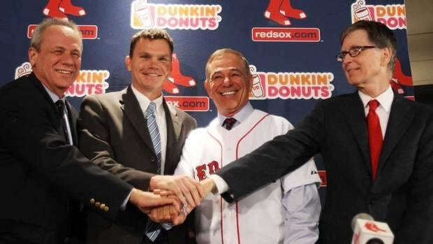 From left to right, president and CEO of the Red Sox Larry Lucchino, executive vice president and general manager Ben Cherington, Bobby Valentine and principal owner John Henry attend a press conference announcing Valentine as the new manager in December of last year.