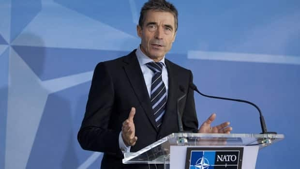 NATO Secretary-General Anders Fogh Rasmussen speaks on Tuesday during a media conference prior to a meeting of NATO foreign ministers at NATO headquarters in Brussels in which the ministers are expected to approve Turkey's request for Patriot anti-missile systems.