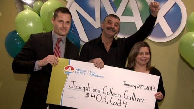 Lotto Max second prize winners Joe and Colleen Gulliver pick up their over-sized $403,624 cheque.