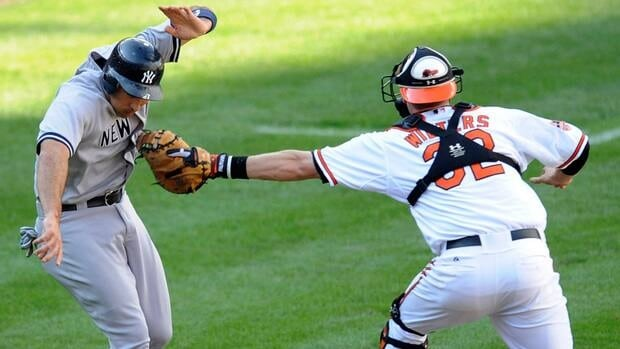 New York Yankees' Raul Ibanez, left, is tagged out by Baltimore Orioles catcher Matt Wieters after he was caught in a rundown on Sept. 9, 2012, in Baltimore.