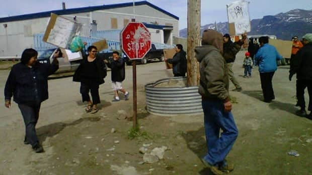 Residents of Pangnirtung, Nunavut, stage a protest against the high price of food in their community on June 21, 2012.