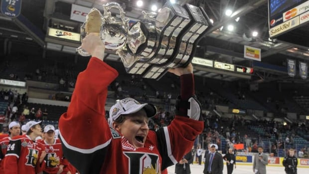 Halifax Mooseheads centre Nathan MacKinnon holds the Memorial Cup after the Mooseheads defeated the Portland Winterhawks in Saskatoon, Sask., on Sunday.