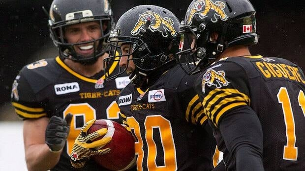 Chris Williams, middle, and the Ticats did their part with a 28-18 home win over Winnipeg on Saturday. They then got a huge helping hand from Montreal, which beat Edmonton on Sunday. Hamilton will need a similar scenario this week to secure a playoff spot.