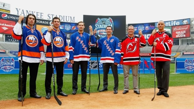 Left to right, Matt Moulson and John Tavares of the New York Islanders, Dan Girardi and Ryan Callahan of the New York Rangers, and Andy Greene and Bryce Salvador of the New Jersey Devils during the 2014 NHL Stadium Series Media Availabilty at Yankee Stadium on August 8.