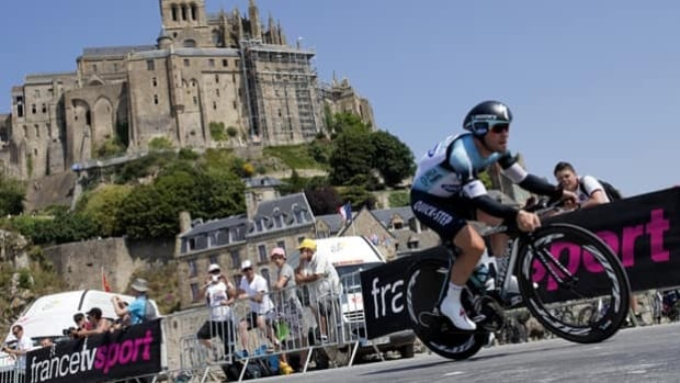 Mark Cavendish peddles past spectators in Wednesday's time trial at the Tour de France.