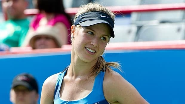 Canada's Eugenie Bouchard smiles as she looks over at her coach while facing Bouchard Shahar Peer from Israel during first round of play at the Rogers Cup tennis tournament Wednesday, August 8, 2012 in Montreal. Bouchard beat Peer 3-6, 6-2, 7-5.