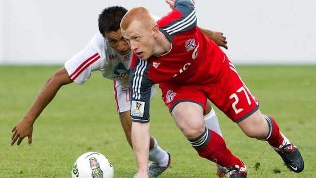 Toronto FC's Richard Eckersley, right, and Real Esteli FC's Manuel Rosas battle for the ball during the first half of a CONCACAF Champions League match on July 17, 2011. Eckersley has signed with TFC after being on loan to the MLS team from England's Burnley.
