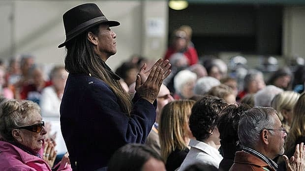 Residential school survivor Leonard James applauds during a Truth and Reconciliation Commission gathering in Victoria last April. A court has ruled the federal government must provide archived records to the commission.