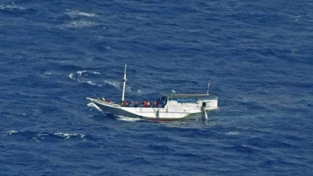The sinking comes just days after Prime Minister Kevin Rudd changed Australia's refugee policy so that people who arrive by boat will no longer be allowed to settle there. In this picture from July 2012, a boat carrying some 180 refugees floats off the Australian coast.