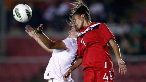 Canada's Rachelle Melhado, right, goes for a header during a CONCACAF women's under 20 soccer final match in March. Ottawa won't be bidding to host the 2014 U-20 tournament in Canada.