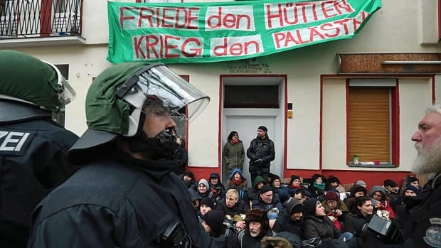 Riot police watch over protesters blockading the entrance to prevent the eviction of a Berlin family on Feb. 14. The case is highlighting controversy over gentrification in parts of Berlin, where rising housing prices are luring investors and forcing long-standing tenants out.