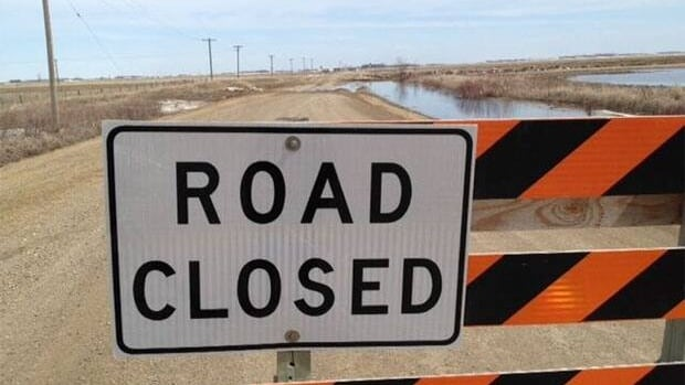 The province has closed off Road 242 due to flooding water.