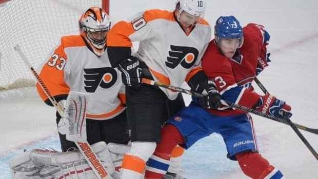 Montreal Canadiens' Brendan Gallagher, right, pressures Philadelphia Flyers' goalie Brian Boucher as Flyers' Brayden Schenn, centre, defends on Saturday night in Montreal.