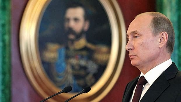 Russian President Vladimir Putin tells a press conference at the Kremlin on July 1 that Edward Snowden can stay in Russia if he wants, as long as he stops leaking U.S. intelligence secrets.