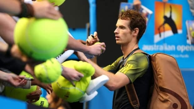 Andy Murray signs autographs following a fourth-round triumph over Gilles Simon on Monday.