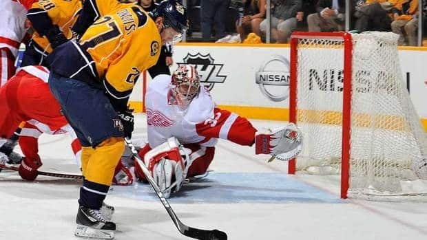 The fourth-seeded Predators capped a season in which they finished ahead of their Central Division rival for the first time by beating the Red Wings for the first time in their third playoff series.
