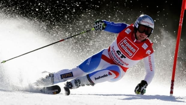 Beat Feuz of Switzerland remains questionable for Sunday's giant slalom in Soelden, Austria.