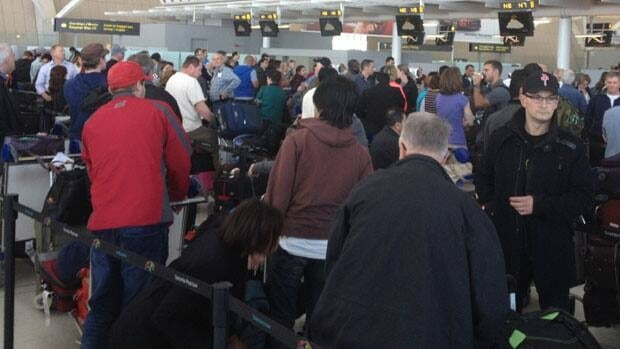 Long lines of travellers wait to check in at Toronto's Pearson Airport on Saturday.