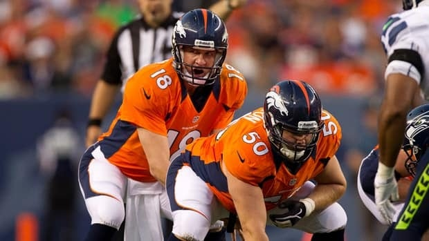 Peyton Manning is with a new team, coming off an extremely serious injury, and trying to help develop a young centre, J.D. Walton.