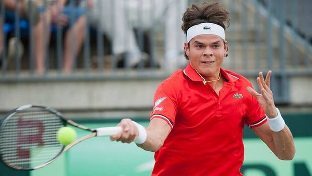 In this photo, Milos Raonic from Canada returns the ball to South Africa's Nikala Scholtz during Davis Cup tennis action in Montreal, Friday, September 14, 2012. Canada's next match against Spain will be held in Vancouver.