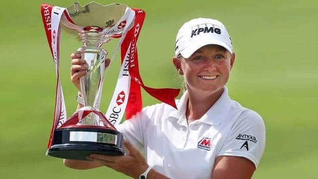 Stacy Lewis of the U.S. poses with the challenge trophy after winning the HSBC Women's Champions golf tournament on Sunday in Singapore.