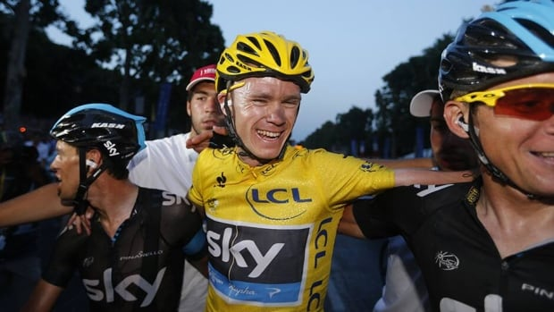 Tour de France 2013 winner Britain's Christopher Froome, centre, celebrates with teammates on the Champs-Elysee avenue in Paris, after finishing the 133.5 km twenty-first and last stage of the 100th edition of the Tour de France cycling race on Sunday.