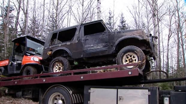The vehicle was pulled out of the pond on Friday morning.
