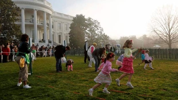 Hopping to it: 100 children scramble for eggs filled with candy, prizes