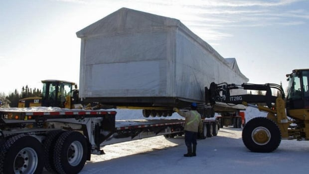 A modular house is loaded onto a truck in this CBC file photo. The Northwest Territories Housing Corporation had signed a contract for 19 to be delivered this year. As of Oct. 20, only four partially built units have been delivered to N.W.T. communities.