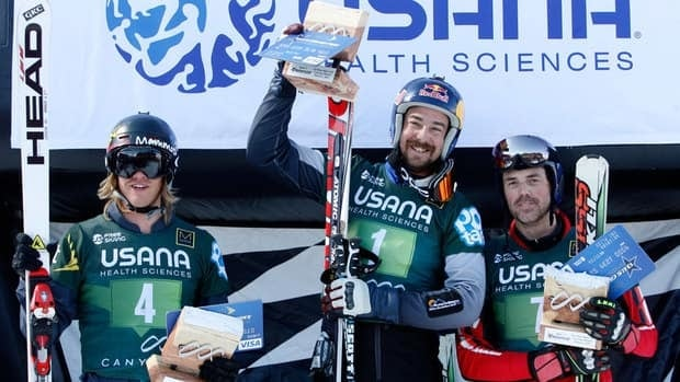 Winner John Teller, centre, is flanked on the podium by second place finisher Tyler Wallasch, left, and third place finisher Stanley Hayer on Friday.