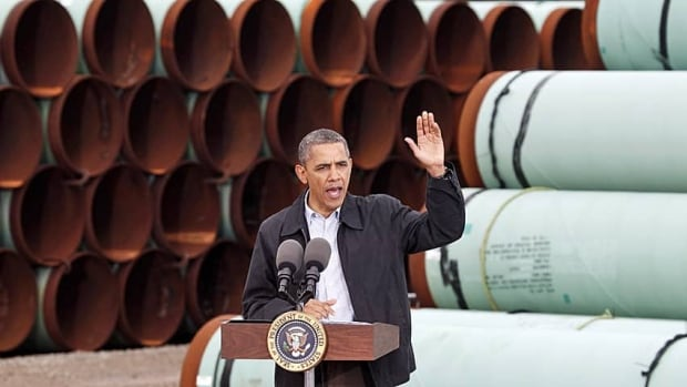 President Barack Obama speaks in front of TransCanada pipes that have yet to be installed in Cushing, Okla.
