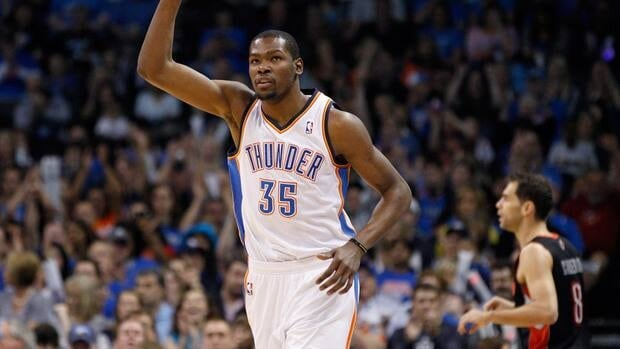 Oklahoma City Thunder forward Kevin Durant reacts after hitting a three-point basket against the Toronto Raptors.