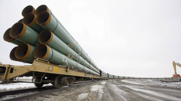 Rail cars arrive in Milton, N.D., in February 2008, loaded with pipe for the first Keystone Pipeline project, which now carries crude oil across Saskatchewan and Manitoba, and through North Dakota, South Dakota, Nebraska, Kansas, Missouri and Illinois.