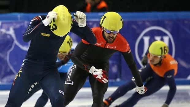 Charles Hamelin, centre, and the Canadian team won gold after the Korean team was penalized.