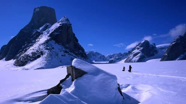 Mount Asgard, a 2,000 metre peak in Auyuittuq National Park on Baffin Island. Charges have been dropped against three international climbers who BASE jumped off Mount Asgard and made an acclaimed film about it.