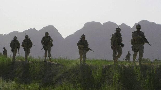 Canadian soldiers patrol an area in the Dand district of southern Afghanistan on Sunday, June 7, 2009.