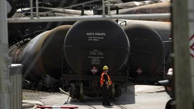 Work continues on Friday at the site in Lac-Megantic, Que., of a train derailment that ignited tanker cars carrying crude oil.