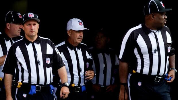 Referee Gerald Wright leads his team of officials to the field before a pre-season game on Aug. 18, 2012. The league locked out the NFL Referees Association in early June, then hired replacements, whose work in exhibition games has been heavily criticized.