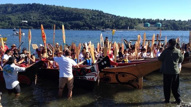 Tsleil Waututh and Squamish canoes arrive in Deep Cove on Saturday