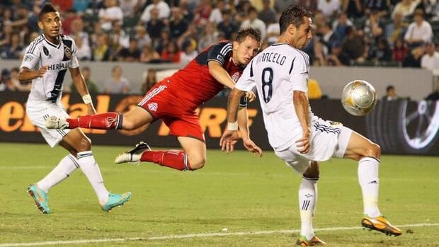 Terry Dunfield (23) of Toronto FC scores in the first half between Sean Franklin #5 and Marcelo Sarvas #8 of the Los Angeles Galaxyon Saturday in Carson, California. However, the Galaxy were already sporting a 3-0- lead by that point.
