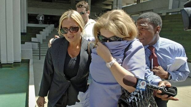 Kim Rothstein, left, wife of Scott Rothstein, walks out of federal court in Fort Lauderdale, Fla., in June 2010 after her husband was sentenced to 50 years for running the largest Ponzi scheme in Florida history.